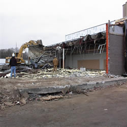 DCC performing the demolition of the Monticello IGA